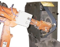 one of two Robot linishers installed to linish roof rail castings.